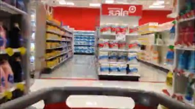 Fast motion of people pushing trolley inside Target store. — Stock Video