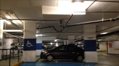 Making exit of underground parking for Thrifty Food shopping. — Vídeo de Stock