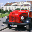 This image presents old car transformed for tourist transportation in Vienn. This image cbe used to associate picture with many activities that cbe done in Vienna. — Stock Photo #15576507