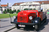 This image presents an old car transformed for tourist transportation in Vienna . This image can be used to associate a picture with the many activities that can be done in Vienna. — Stock Photo