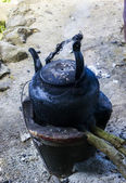 Old Black kettle on fire — Stock Photo