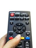 Remote control in hand — Stock Photo
