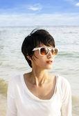 Short hair Asian woman on the beach — Stock Photo