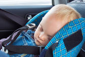 Little baby sleeping in a car seat — Stock Photo