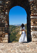Romantic woman near arch of medieval town — Stock Photo