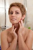 Woman in the bathroom — Stock Photo