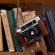 Camera and books — 图库照片