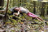 A dead girl's body found in the forest — Stock Photo