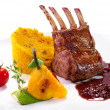 Rack of lamb with vegetables and couscous - Stock Photo