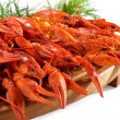 Boiled crawfish on the wooden plate — Stock Photo #19875717