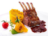 Rack of lamb with vegetables and couscous — Stock Photo