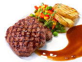 Rib-eye steak with vegetables — Stock Photo