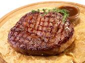 Rib-eye steak resting — Stock Photo