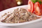 Mushrooms in a creamy sauce — Stock Photo