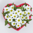 Bouquet of flowers in a heart-shaped Valentine's Day — Stock Photo #21664363