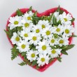 Bouquet of flowers in a heart-shaped Valentine's Day — Stock Photo