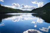 Sky reflection in river — Stock Photo