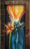 Street art - open door art - blue flames — Stock Photo