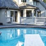 Backyard heated Swimming Pool — Stock Photo #11535549