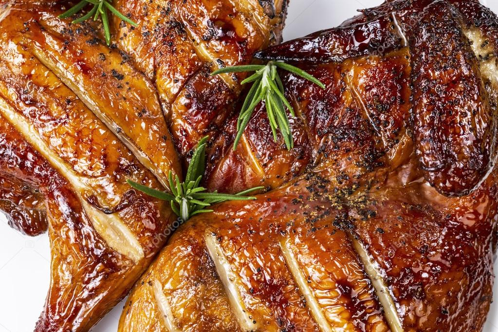 Fresh barbecued smoked half hen chicken with rosemary on top — Stock Photo #12122833