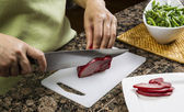 Slicing Pork Meat — Stock Photo