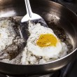 Eggs cooked with bacon grease in pan — Stock Photo