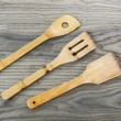 Wooden Spatulas on Old Ash Wood Board — Stock Photo