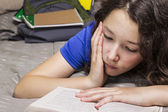 Too much homework for girl — Stock Photo