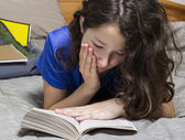 Young Girl Reading Book in Bedroom — Stok fotoğraf