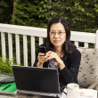 Mature women working at home office outside — Stock Photo