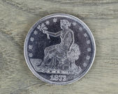 Silver Trade Dollar on Faded Wood — Stock Photo