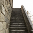 Steep Stairway to the Great Wall in China - Stock Photo