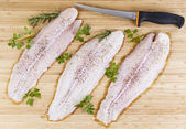 Fresh Fish Fillets with Fillet Knife — Stock Photo