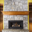 Natural Gas Fireplace and Crafted Stone and Wood Mantels — Stock Photo