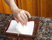 Picking Napkins out of basket — Stock Photo