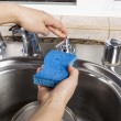 Soap from Dispenser from Kitchen Sink — Stock Photo #17870375
