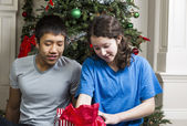 Brother and Sister Checking Holiday Gifts — Stock Photo