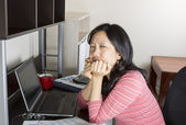 Mature women stressed from doing income taxes — Stock Photo