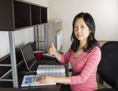 Positive Mature Asian Doing Personal Income Taxes — Stock Photo
