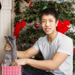 Young Man with Holiday Gifts — Stock Photo