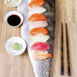 Sushi on Large Salmon Fillet serving as plate - Stock Photo