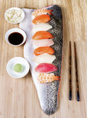 Sushi on Large Salmon Fillet serving as plate — Stock Photo