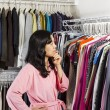 Mature woman deciding what clothing to wear — Stock Photo