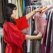 Mature woman coordinating her Clothes — 图库照片