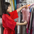 Mature woman coordinating her Clothes — Stockfoto