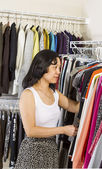 Mature woman dressing within walk-in closet — Stock Photo