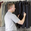 Mature man deciding what clothing to wear — Stock Photo