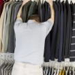 Mature man not happy while getting dressed — Stock Photo