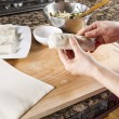 Stock Photo: Wrapping up Chinese Spring Roll