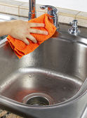 Female hand Drying Kitchen Sink — Stock Photo